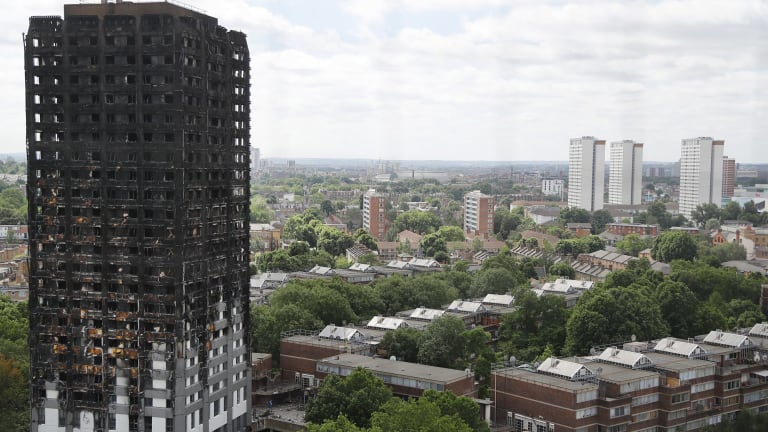 The burnt-out shell of the Grenfell Tower apartment building in London.