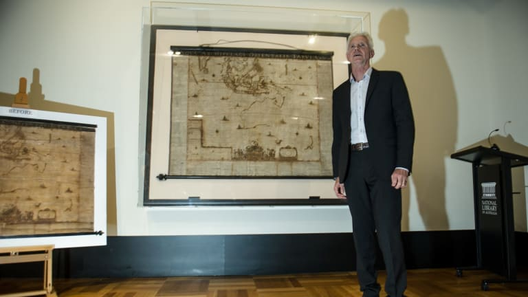 The National Library of Australia's curator of maps, Dr Martin Woods with Archipelagus Orientalis (Eastern Archipelago).
