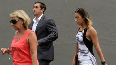 Mitchell Pearce arrives to speak at a press conference in Surry Hills on Friday with his mother Terri, left, and sister Tatum, right.