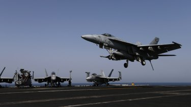 A F/A-18E Super Hornet of Strike Fighter Squadron (VFA-31) lands on the flight deck of the aircraft carrier USS George H. W. Bush in the Gulf after striking Islamic State targets in Iraq last year.