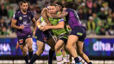 Rough and tumble: Shannon Boyd gets some attention during the round 23 match between the Raiders and the Storm.
