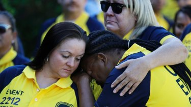 Kim Bartlett, left, comforts Cassandra Johnson before a funeral for their coworker who was killed in the Las Vegas shooting.