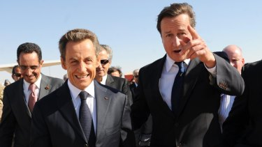 Former British PM David Cameron, right, and former French President Nicolas Sarkozy arrive in Benghazi, Libya, in 2011.