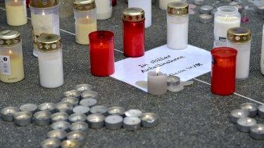 Candles outside the Josef-Koenig-Gymnasium high school in Haltern am See.
