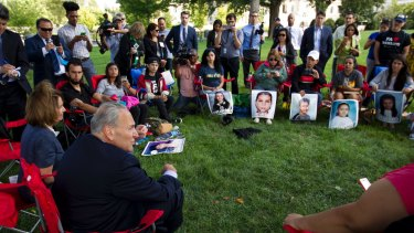 Democrats Nancy Pelosi and Chuck Schumer speak with Dreamers on Capitol Hill in September.