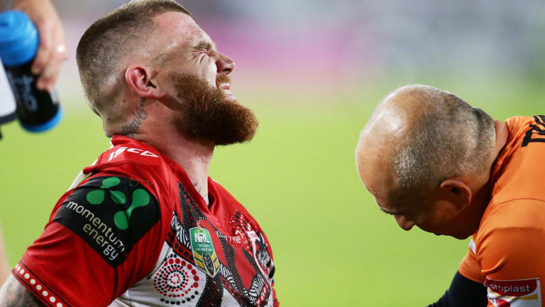 Painful blow: Josh Dugan shows discomfort after suffering an arm injury during the round 11 NRL match between the South Sydney Rabbitohs and the St George Illawarra Dragons at ANZ Stadium on May 19.