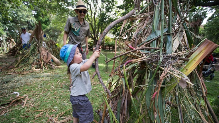 Andrew Chua and his two-year-old son Zan put the finishing touches on their cubby.