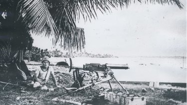 NOT PACIFIC: A German sailor from the Emden establishes a machine gun position on the Cocos Islands.