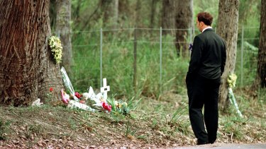 Walter Mikac front of the tree where his daughter was killed at the one-year memorial service of the Port Arthur massacre.