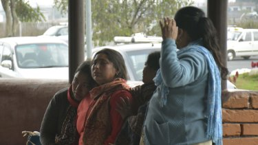 Relatives break down while waiting for information about the accident at Pokhara Domestic Airport.