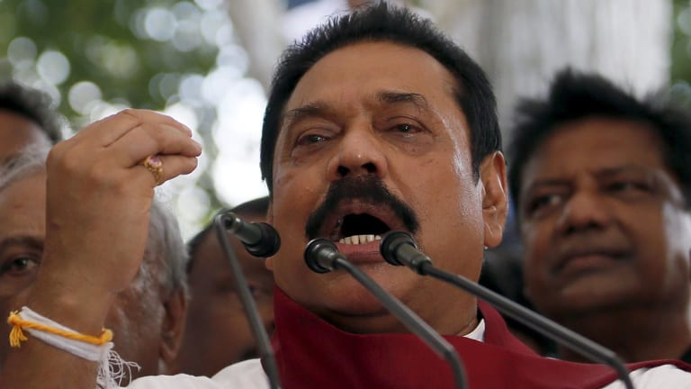 Former Sri Lankan president Mahinda Rajapaksa with his supporters on Wednesday.