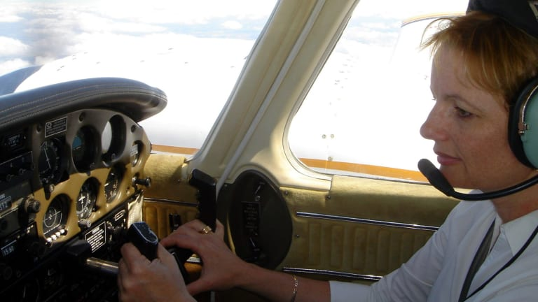 Ms Ley at the controls of her light plane.