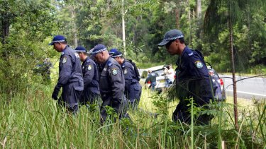 Police searching bushland in Bonny Hills, south of Port Macquarie, in 2015, as part of investigation.
