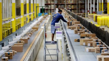 """The vast majority of Amazon's hiring is for what the company calls its """"fulfilment network"""" - the armies of people who pick and pack orders in warehouses and unload and drive delivery trucks."""