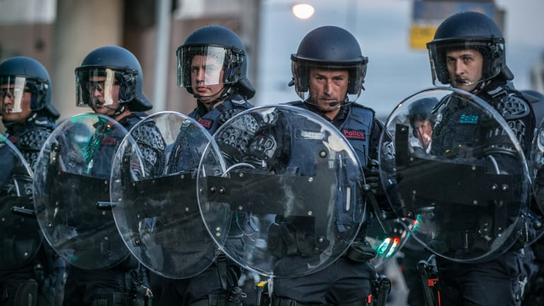 Police in riot gear prepare to deal with violent clashes between protesters outside the Milo Yiannopoulos event in Kensington on Monday.
