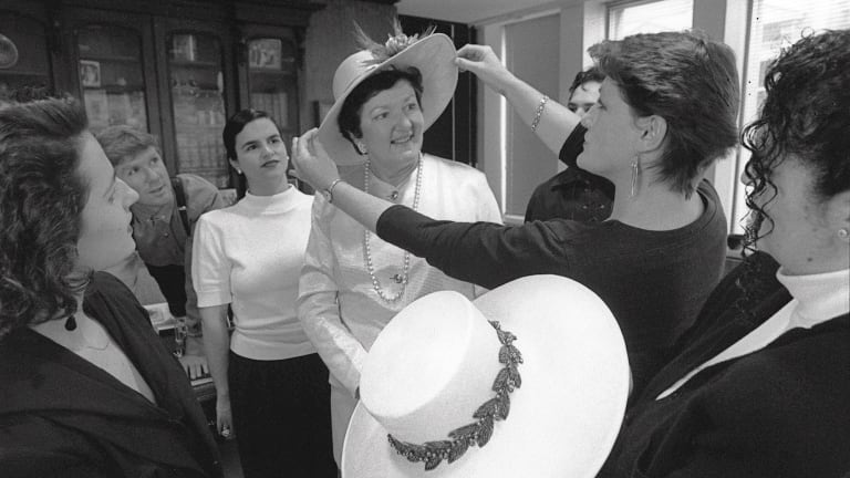 In 1991, Joan Kirner tries on one of two hats made for her by clothing studies students at Broadmeadows College of TAFE to wear to the Cup and Oaks Day.
