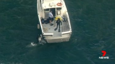 Police divers at the scene of the plane crash.