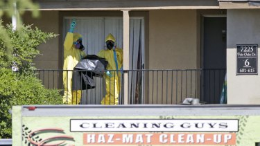Infection risk: A hazardous material crew works at the apartment where Thomas Eric Duncan stayed in Dallas.