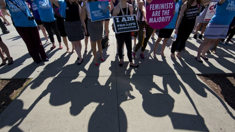 Demonstrators on both sides of the abortion issue stand in front of the Supreme Court in Washington in June.