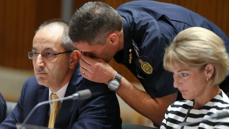 Department of Immigration and Border Protection secretary Michael Pezzullo and Australian Border Force commissioner Roman Quaedvlieg in discussion during an estimates hearing at Parliament House.
