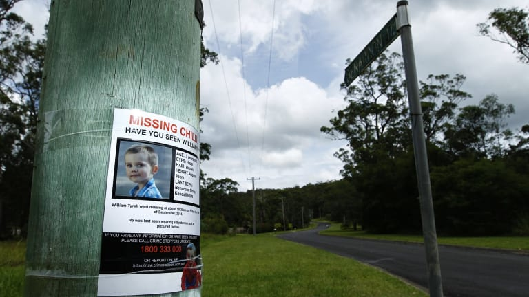 A poster on a telegraph pole at the start of Benaroon Drive, Kendall asking for information about missing toddler William Tyrrell.
