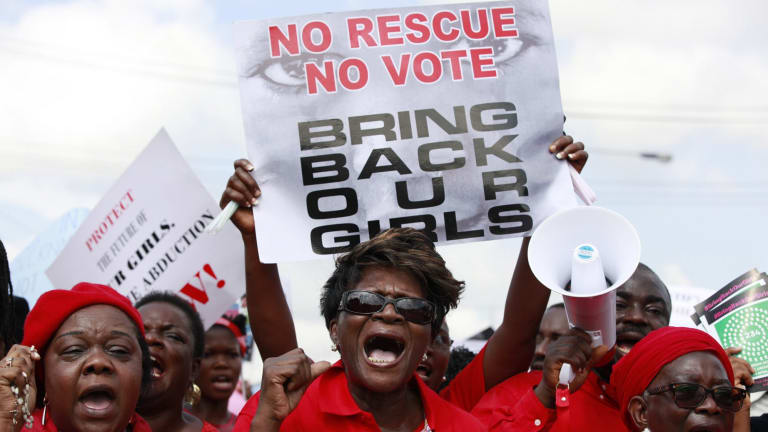 Women attend a demonstration calling on the government to rescue the kidnapped Chibok school in Lagos, Nigeria, in  2014.