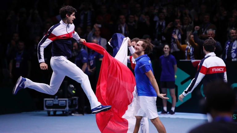 France's Pierre-Hugues Herbert jumps after Lucas Pouille defeated Belgium's Steve Darcis.