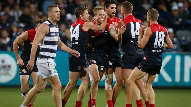 The Demons celebrate after defeating Geelong on Sunday.