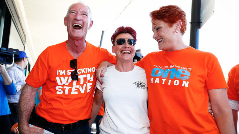 One Nation Queensland leader Steve Dickson and Senator Pauline Hanson meet voters at a polling booth in Buderim on Friday. Dickson is considered unlikely to win a seat.