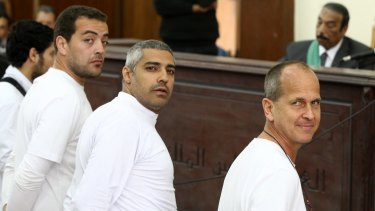 Al-Jazeera producer Baher Mohamed, left, Canadian-Egyptian bureau chief Mohammed Fahmy, centre, and Peter Greste in March 2014.