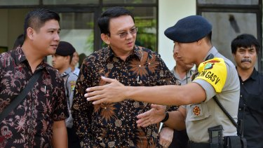 Jakarta Governor Basuki Tjahaja Purnama, popularly known as Ahok (centre), faces five years in prison if found guilty of blasphemy.