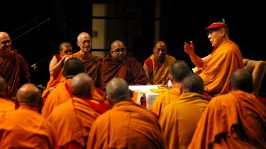 His Holiness The 14th Dalai Lama of Tibe (right) teaching Buddhist monks and practitioners in Brisbane in June.