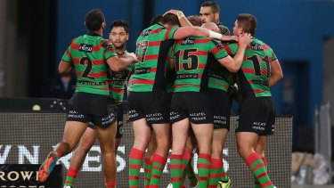 Much-needed win: South Sydney Rabbitohs players celebrate Aaron Gray's first try.
