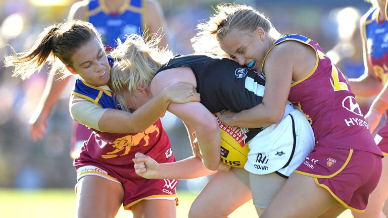 Magpie Sarah D'Arcy is pressured by the ferocious Lions.