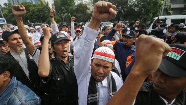 Muslim protesters shout slogans during a rally outside court on Tuesday.
