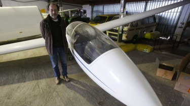 Aviation club member Peter Ruecker stands beside a glider that was flown by Andreas Lubitz in the hangar of the club in Montabaur, Germany on Thursday.
