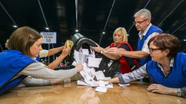 Counters begin to tally ballot papers at the Titanic Exhibition Centre in Belfast, where the Northern Ireland results were calculated.