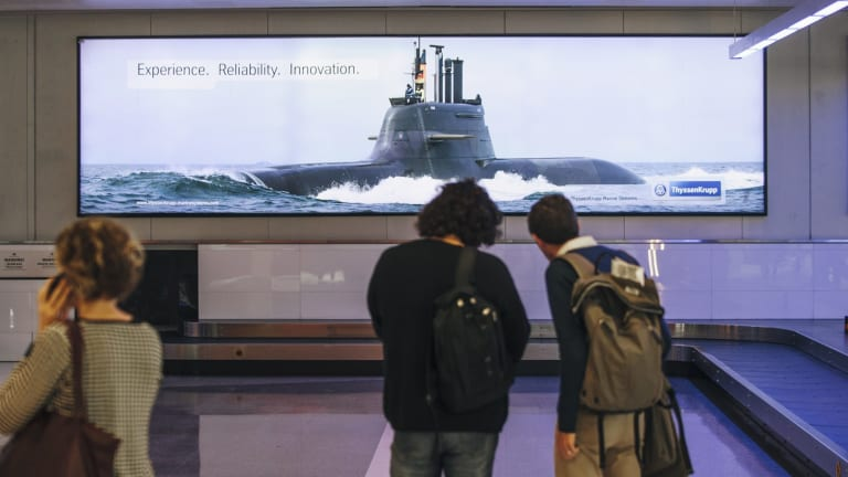 The No Airport Arms Ads campaign is petitioning for the removal of material promoting military arms at Canberra Airport.