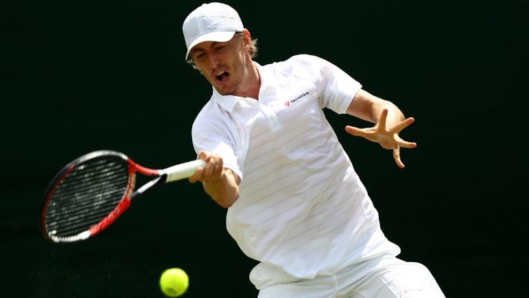 Australia's John Millman toughed it out through a five-set match to reach Wimbledon's second round.
