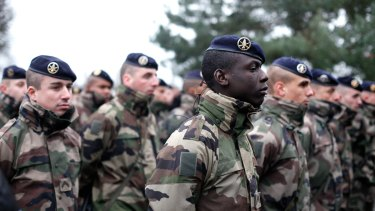 French soldiers line up to listen to a speech by the  French Defence Minister Jean Yves Le Drian, at the Satory military camp in Versailles, west of Paris,