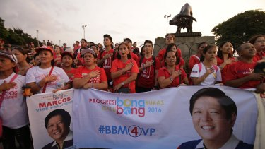 Supporters of vice presidential candidate Senator Marcos  hold a protest in Manila on Wednesday. Election officials challenged Marcos to prove his allegation of irregularities in vote counting.