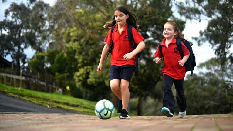 Jess with her sister,, Emma, 6, who shifts between her school uniform's trousers, shorts and dresses.