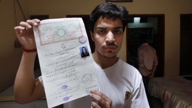 Hassan Khan shows his marriage certificate to media at his home in Lahore, Pakistan on Wednesday.