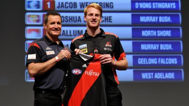 Aaron Francis with Essendon coach John Worsfold in Adelaide on Tuesday night.
