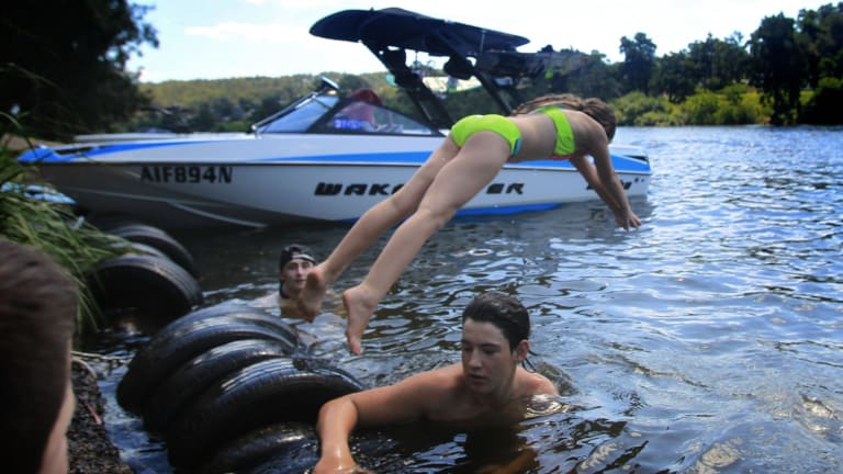 Children took to the Nepean River at Penrith as the mercury rose into the 40s on Sunday.