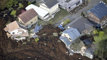 Houses are buried in a landslide caused by an earthquake in Minamiaso, Kumamoto prefecture, on Saturday.