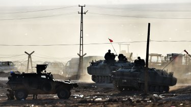Armoured vehicles of the Turkish army patrol along the Turkish-Syrian border.