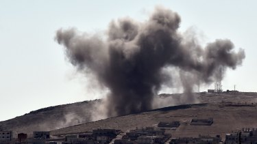 Targeting Islamic State positions: Smoke rises following an air strike on the eastern sector of the Syrian town of Kobane.