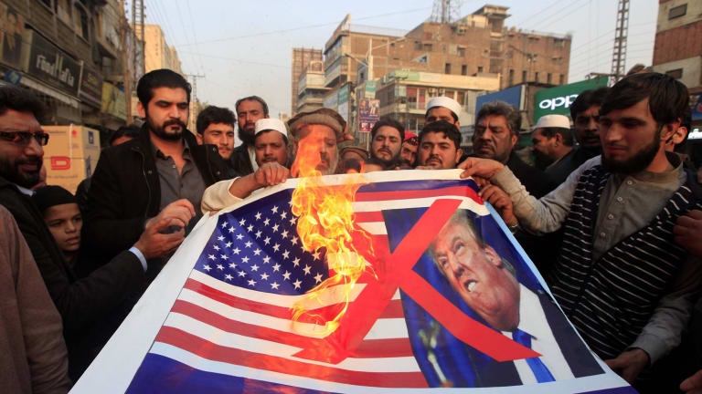Pakistani traders protest against  Donald Trump in Peshawar, Pakistan, on Friday.