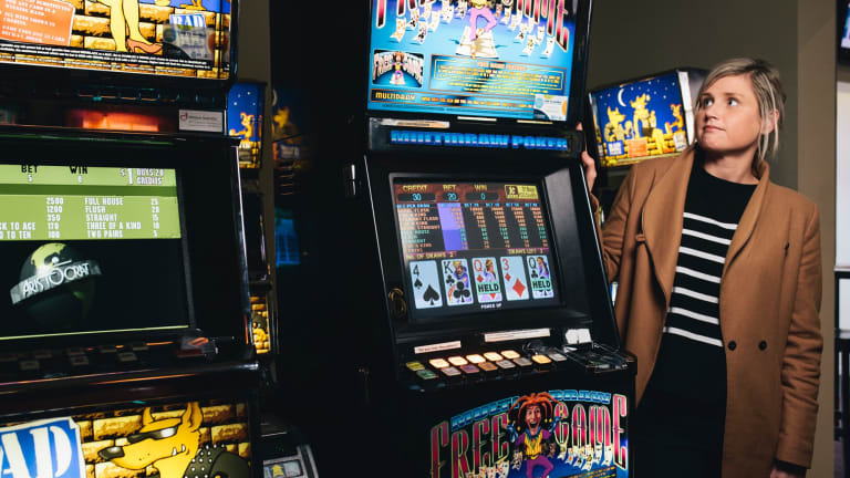 Australian Hotels Association ACT's Jo Broad with aging poker machines at the Statesman Hotel in Curtin.